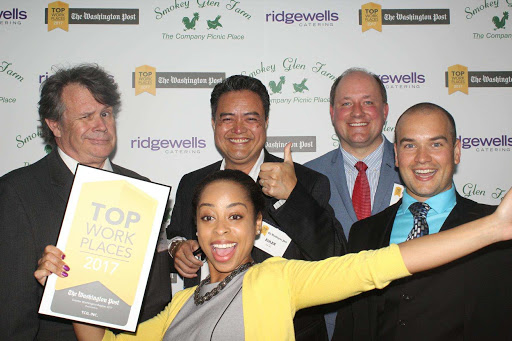Five TCG staff celebrate a Washington Post Top Workplace award.
