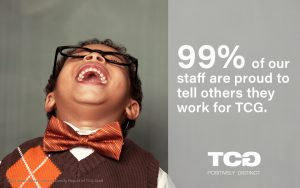 Boy laughing. Text reads: 99% of our staff are proud to tell others they work for TCG.