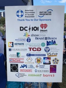 Sign showing that TCG was a sponsor of the American Foundation for Suicide Prevention Out of the Darkness Walk.