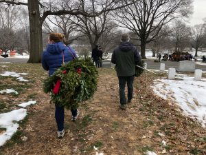 TCGer carrying Christmas wreaths away at Arlington National Cemetery.