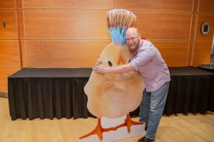 TCG President Daniel Turner hugging a 6-foot chick.