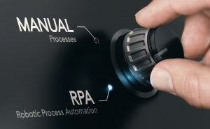 Hand turning a dial from manual process to robotic process automation.