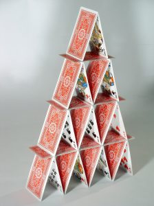 Playing cards assembled to look like a house.